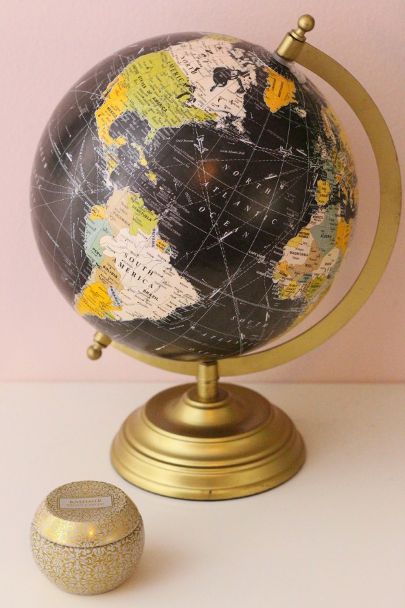 gold candle + globe